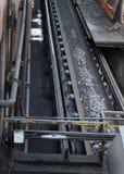 Coke on conveyor belt. Stock Photos