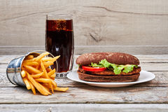 Coke and fries on wood. stock photo