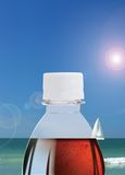 Coke and sky. Interesting combination of coke, sky and boat aligned together Royalty Free Stock Photos