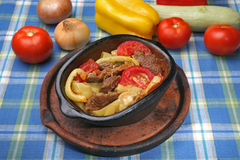 Coked pork meat with vegetables Stock Images