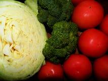 Col, bróculi principal, tomates Foto de archivo libre de regalías