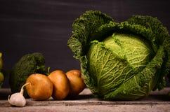 Col, coliflor, bróculi, patata, cebolla Fotos de archivo libres de regalías