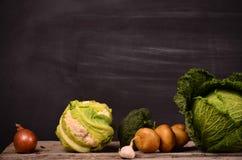 Col, coliflor, bróculi, patata, cebolla Imagen de archivo libre de regalías