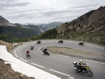 Group of men on motorcycle reaches col d`izoard in the french haute provence alps. Col d`izoard, france, 10 june 2018: group of men on motorcycle reaches col d` stock images