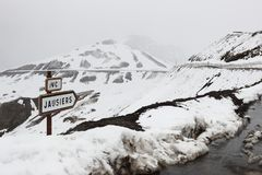 Signposting at Col de la Bonette, snowy Maritime Alps, France Stock Photos