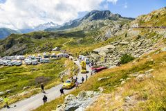LCL Caravan in Alps - Tour de France 2015. Col de la Croix de Fer, France - 25 July 2015: LCL caravan driving on the road to the Col de la Croix de Fer in Alps Royalty Free Stock Image