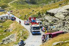 Service Truck in Alps - Tour de France 2015. Col de la Croix de Fer, France - 25 July 2015: The service truck transports a broken Vittel vehicle on the road to Royalty Free Stock Image