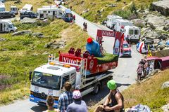 Service Truck in Alps - Tour de France 2015. Col de la Croix de Fer, France - 25 July 2015: The service truck transports a broken Vittel vehicle on the road to Stock Photography
