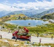 Vittel Caravan in Alps - Tour de France 2015. Col de la Croix de Fer, France - 25 July 2015: Vittel caravan driving on the road to the Col de la Croix de Fer in Stock Images
