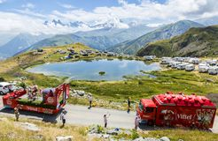Vittel Caravan in Alps - Tour de France 2015. Col de la Croix de Fer, France - 25 July 2015: Vittel caravan driving on the road to the Col de la Croix de Fer in Royalty Free Stock Images
