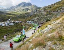 Teisseire Caravan in Alps - Tour de France 2015. Col de la Croix de Fer, France - 25 July 2015: Teisseire caravan driving on the road to the Col de la Croix de Royalty Free Stock Images