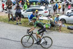The Cyclist Pierre Rolland - Tour de France 2015. Col du Glandon, France - July 24, 2015: The French cyclist Pierre Rolland of Europcar Team,climbing the road to Royalty Free Stock Images