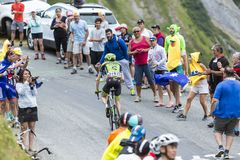 The Cyclist Dan Martin - Tour de France 2015. Col du Glandon, France - July 24, 2015: The Irish cyclist Dan Martin of Cannondale-Garmin Team,climbing the road to Royalty Free Stock Images