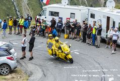 The Yellow Bike - Tour de France 2015. Col du Glandon, France - July 24, 2015: The yellow LCL bike driving on the road to Col du Glandon in Alps, during the Royalty Free Stock Images