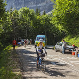 Amateur Female Cyclist. Col du Granier,France-July 13th, 2012: A British amateur female cyclist climbing the road to mountain pass Granier before the passing of royalty free stock image