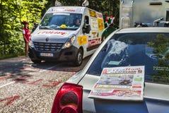 Le Tour de France Official Daily Newspaper. Col du Granier,France-July 13th, 2012: The official daily newspaper (L'Eaufficiel de la Caravane) is on a car parked Stock Photography