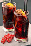 Cola alcoholic cocktail. Cola alcoholic cocktail and fruits Royalty Free Stock Image