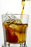 Cola being poured in to a glass from a height Stock Photography
