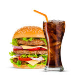Cola and Big hamburger on white background. Cola and Big beautiful juicy burger with meat and vegetables. Isolated on white background Royalty Free Stock Image