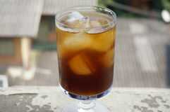 Cola, black coffee, on champagne glass. On balcony of an old building Royalty Free Stock Images
