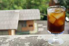 Cola-black coffee. Cola, black coffee, on champagne glass on balcony of an old building Stock Photography