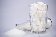 Cola Bottle with Sugar and Sugar Cubes Royalty Free Stock Images