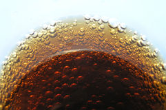 Cola bubbles in glass. A perspective shot of cola in glass with lots of bubbles stock photos