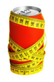 Cola can and measuring tape royalty free stock photography