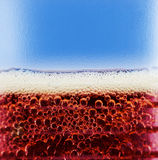 Cola close up. Cola with bubbles and foam close up Stock Images