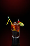 Cola coctail with decoration. Cola coctail with cherry, lemon, lime and straw Royalty Free Stock Photography