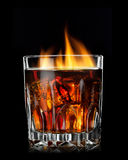Cola with cognac and fire in glass Stock Photo