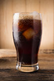 Cola. Cold fizzy cola soda with ice in glass cup Stock Photo
