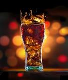 Cola con hielo Imágenes de archivo libres de regalías