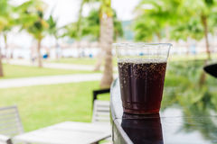 Cola or Cuba Libre cocktail. Drink in glass at the bar on the beach Stock Photo