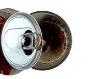 Cola de derramamento no vidro Imagem de Stock Royalty Free