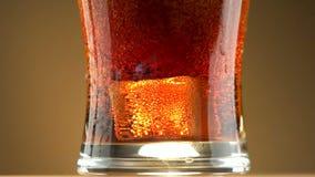 Cola de vidro da soda do gelo filme