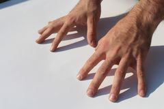 Cola del cuerpo del concepto del finger de la mano del hombre Imagen de archivo libre de regalías