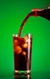 Cola di versamento Fotografie Stock
