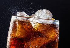 Cola drink. A cool glass of cola drink with ice, bubbles and fizz Royalty Free Stock Image