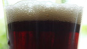 Cola drink in glass - closeup. HD 1080 static: Cola drink poured into glass - lots of bubbles - closeup stock footage