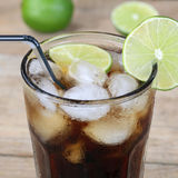 Cola drink in glass with ice cubes Royalty Free Stock Photos
