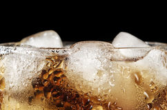 Cola drink with ice close up isolated on black. Cola drink with ice and bubbles close up isolated on black Stock Photo