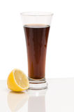 Cola drink with lemon. Cola drink on glass table with lemon slice on the left royalty free stock images