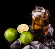Cola Drinks With Ice Cube and Lime II Stock Image