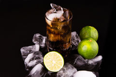 Cola Drinks With Ice Cube and Lime IV Stock Photos