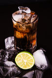 Cola Drinks With Ice Cube and Lime IX Royalty Free Stock Image