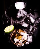 Cola Drinks With Ice Cube and Lime VI Royalty Free Stock Images