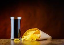 Cola e patatine fritte degli alimenti industriali Fotografia Stock