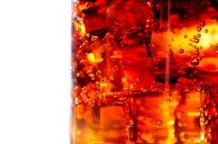 Cola en el primer de cristal Fotografía de archivo libre de regalías