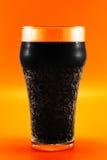Cola gelada na laranja Imagens de Stock Royalty Free